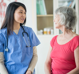 Healthcare provider talking with woman