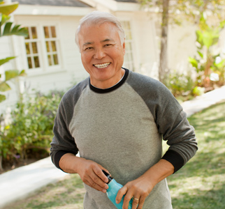 Older man outdoors with water bottle